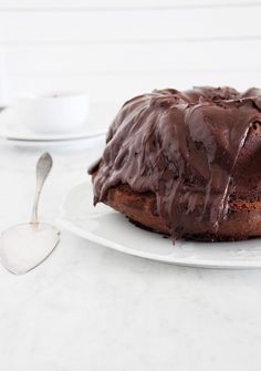 lindt chocolate bundt cake with ganache frosting & pomegranate