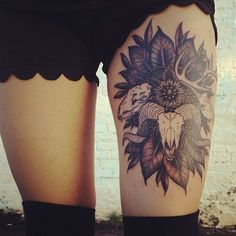Skull-thigh-tattoo.. with white leaves/flowers.. slightly obsessed with skulls… probably would never get it but still beautiful.