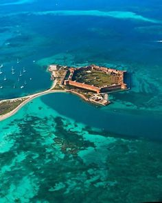 Dry Tortugas National Park is a national park about 68 statute miles west of Key West in the Gulf of Mexico. The park preserves Fort Jefferson and the seven Dry Tortugas islands, the westernmost and most isolated of the Florida Keys. Vacation Places, Dream Vacations, Vacation Spots, Places To Travel, Travel Destinations, Dry Tortugas, Places Around The World, Oh The Places You'll Go, Places To Visit