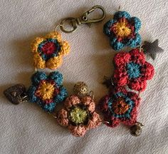 Bohemian bracelet using crocheted flowers and little charms.