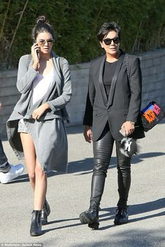 Busy bee: Kendall Jenner is locked into a conversation despite walking along with her mother Kris Jenner in Beverly Hills