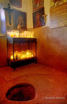 Anteroom in Santurio de Chimayo with hole in the floor said to contain dirt that conveys miraculous healing power.