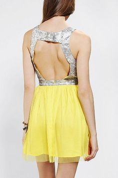this dress is GORGEOUS. Has a shiny, brocade top with a breezy yellow skirt!!