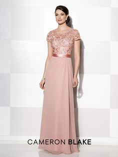 Chiffon and lace A-line gown with lace illusion short sleeves and scoop neckline, sweetheart bodice, lace illusion back, satin ribbon at natural waist, side draped skirt. Matching shawl included. Sizes: 4 – 20 Colors: Dark Blue, Silver, Rose, Royal Blue, Mauve, Green