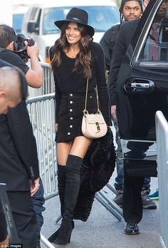 Beauty in black: Potuguese beauty Sara Sampaio showed some thigh in a suede skirt and knee-high boots