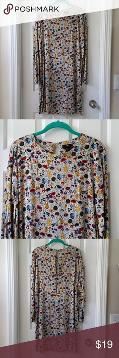 [JUST ADDED] H&M Printed Dress H&M Printed Dress. Long Sleeve lightweight fabric. Two button peekaboo back. Pretty colorful prints. 100% Viscose. Excellent condition. Length from shoulder to hem is approx 37 inches. H&M Dresses Long Sleeve