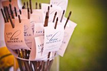 Custom notes on sparklers for wedding exit.