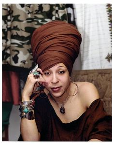 Netfah Bell shows us how to rock a towering headwrap fro with style and grace!