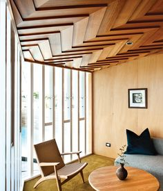 Gorgeous herringbone ceiling in Auckland, New Zealand modernist home. Architect Michael O'Sullivan. Hans J. Wegner easy chair and coffee table. Photo by Emily Andrews / Dwell. #mcm