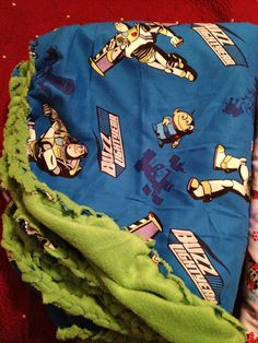 Buzz Lightyear Blanket, knitted edge. sewn, to prevent unraveling.
