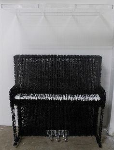 Augusto Esquivel, Upright Piano made of hanging buttons..