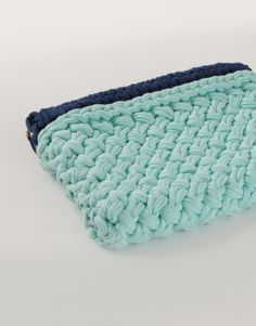 Hold Tight Clutch: This Hold Tight Clutch comes in a colour way of Sea Foam with Dark Blue trim. A great summer into autumn design, it'll be your favourite clutch to liven up any day or night outfit. Height 25cm Width 21cm The super soft T-shirt Yarn is made of cotton jersey from Peru.
