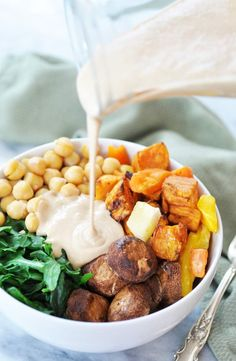 Root vegetable power bowl with roasted garlic tahini dressing Root Vegetable Power Bowl & Roasted Garlic Tahini Dressing! This super bowl recipe is filled with the healthiest vegetables and pulses that you can eat. Roasted Root Vegetables, Healthy Vegetables, Steamed Vegetables, Tahini Dressing, Oil Free Salad Dressing, Buddha Bowl Vegan, Buddha Bowl Sauces, Vegan Weeknight Meals, Whole Food Recipes