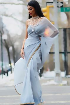 A subtle dusk blue chiffon sari with faux fur trim, paired with a matching suede corset top & detachable pearl embellishment. A classy, sophisticated display of the sari. Sexy Party Dress, Sexy Dresses, Evening Dresses, Fashion Dresses, Dresses 2016, Fashion Top, Classy Fashion, Travel Fashion, Prom Gowns
