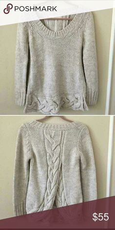 Zara Knit Cream, split back sweater Zara Knit split back sweater . Flared front with Braid on the bottom, slits on sides. Braided back with opening. Soft and warm. Wool blend. Size M. Length from shoulder is 28 and slightly longer by an inch in the front. I purchased this on another site, and it's just slightly too small for me :( Absolutely love it :( Zara Sweaters