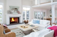 """beach house:  Main Room Paint color - Benjamin Moore """"Winds Breath"""", mixed at 75% saturation;  Striped Rug- Dash and Albert Yacht Stripe (3 rugs sewn together to get the large square size); Lantern- Urban Electric Co, custom finish (""""seaside bronze"""" washed in a white to soften it up)"""