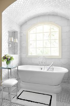 bathrooms - alcove marble basketweave tiles floor polished nickel etagere stool tumbled marble surround black white bath mat Vendome Double Sconce Waterworks Easton Etagere Waterworks Easton Stool Waterworks Sahara Bath Rug Restoration Hardware Palais Pedestal Tub