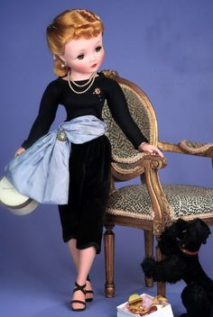 Cissy wearing her Black Capris Set by Madame Alexander from 1957 of black jersey top accented with jewels, black velvet Capri pants with blue taffeta obi sash.