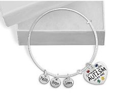 """Someone With Autism Loves Me Retractable Charm Bracelet. Autism Awareness Bracelet One brand new Someone With Autism Loves Me retractable charm bracelet  Bracelet size: 8 1/2 inches  Charm: 1 inch tall x 1 inch wide  Word Charms: 3/8 in diameter This sterling silver plated autism awareness retractable charm bracelet features an autism awareness heart charm that reads """"Someone With Autism Loves Me"""" with colored puzzle pieces. The autism heart charm is 1 inch tall by 1 inch wide. This bracelet…"""