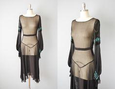 20s Dress // 1920s Sheer Black Silk Beaded Dress // Medium by OffBroadwayVintage on Etsy https://www.etsy.com/listing/216138150/20s-dress-1920s-sheer-black-silk-beaded