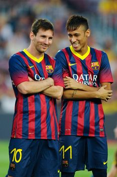 Lionel Messi (L) and his team-mate Neymar of FC Barcelona jokes during the FC Barcelona offcial presentation prior to a friendly match between FC Barcelona and Santos at Nou Camp on August 2, 2013 in Barcelona, Catalonia.