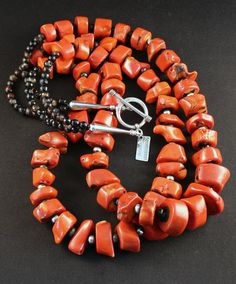 This engaging Necklace displays 2 strands of Vintage Bamboo Coral in vibrant shades of coral-red. The Stones are graduated – ranging in size from 12-to-24mm – and have been cut in a chunky style, givi