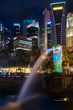 The Iconic Singapore Merlion With The City Skyline In The Background, Marina Bay