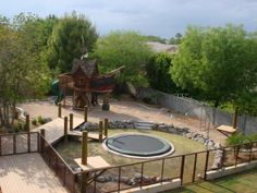 Cool Backyard with pirate treehouse and inground trampoline