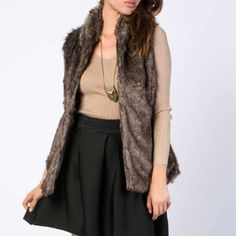 c o m i n g s o o n : Chic Faux Fur Vest ONLY ONE AVAILABLE COMMENT TO BE NOTIFIED UPON ARRIVAL. Size Medium. Turn heads in this collared faux fur vest. Features a belt with 2 loops at either side. Material: 100% Polyester (Faux Fur) ACTUAL COLOR DEPICTED IN FIRST PHOTO. OTHER PHOTOS SHOW FIT Jackets & Coats Vests
