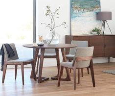 Scandinavian Designs - The Cress round dining table will nurture your inner perfectionist with its equal focus on angles and curves. The unique angled legs of this solid American walnut table balance beautifully against the beveled circular tabletop. Round Table And Chairs, Kitchen Table Chairs, Dining Room Chairs, Circular Dining Table, Side Chairs, Dining Table With Chairs, Dining Set, Black Round Table, Round Tables