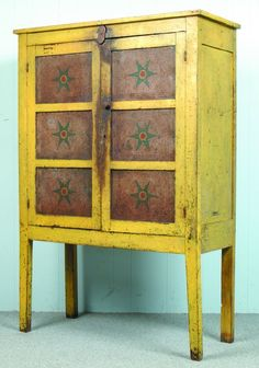 """Mid-Western Ohio Chrome Yellow Painted Softwood Punched Tin Pie Safe, rectangular form with paneled sides and straight legs, two interior shelves, six pierced decorated tin panels with polychrome painted stars on front, 60-½""""h. x 41""""w. x 16-¾""""d., (wear to paint and surface, tin oxidized). ~♥~."""