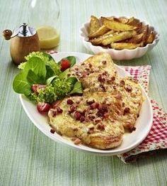 Das Rezept für Überbackene Putenschnitzel mit Kartoffelspalten und weitere kostenlose Rezepte auf LECKER.de