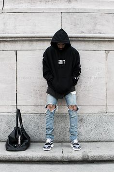 Jerry Lorenzo wearing Fear of God Selvedge Denim Jean, Y-3 Primeknit Pure Boost ZG Sneakers, Fear of God x Champion Purpose Tour Staff Hoodie
