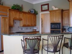 Sherwin Williams Svelte Sage with oak cabinets