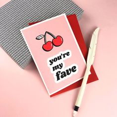 YOU'RE my FAVE greetings card// Cherry card, pink greetings card Valentines Card Design, Valentines Day, Valentines Illustration, Greeting Card Shops, Colored Envelopes, Typography Prints, Love Cards, Anniversary Cards, Red And Pink