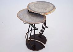 Nesting Tables with Agate tops sit on wrought iron bases in a lily pad motif.