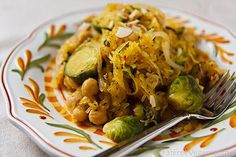 Ingredients        1 spaghetti squash      1 pound Brussels sprouts      1 medium onion, halved and thinly sliced      3 cloves garlic, pressed      1/2 cup vegetable broth      15 ounces chickpeas, rinsed and drained      2 teaspoons dried basil      1/4 teaspoon red pepper flakes (or to taste)      salt and black pepper, to taste      1 1/2 teaspoon lemon juice      sliced almonds, optional