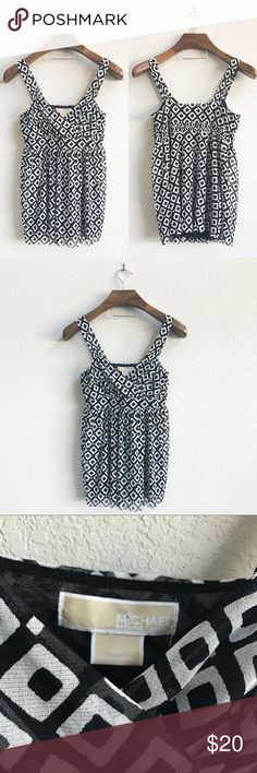 Michael Kors Black and White Diamond Print Tank Pre-loved but in good condition! No stains, snags, or tears upon inspection.   PRODUCT DETAILS: •Size: Medium •Colors: Black, White •Made in Philippines •Measurements: Chest-14.5inch Length-27.5inch •Diamond Print  •Sheer Mesh Fabric  •Empire Waist, elastic in back •Ruched Tank Top Straps •Lined with a black mesh layer • 100% nylon •Machine wash (In Laundry Bag)  Tags: shirt blouse work career professional business school church MICHAEL Michael…