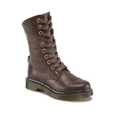 Biker culture has been anti-establishment from its very beginnings in the 1950s. It has also developed a very distinctive style. The 9-Eye Toe Cap Aimilita is a calf-height boot with a fold-down option and uses a D-ring to attach the folded down upper to the rear of the ankle, instead of the usual buckle. When folded down, this offers multiple looks from one boot. A comfort last specifically designed to fit a female foot is used.9 Eye Toe Cap Boot . Dark Brown Polished Wyoming leather- has a…