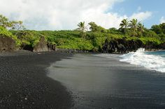 I walked this stunning black volcanic beach in Maui.  Could barely believe what was under my feet.  Such beauty and drama
