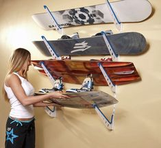 Wakeboard Storage Rack... we need this for wakeboards and snowboards and longboards and skateboards...