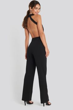 This jumpsuit features a high neck, an open back design, straight legs and a button closure at the back of the neck. Playsuits, Jumpsuits, Black Jumpsuit, Strappy Heels, Jean Outfits, Body Measurements, Trousers, Jeans, Clothes