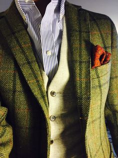 Nice pairing of greens... pale vest and plaid jacket.