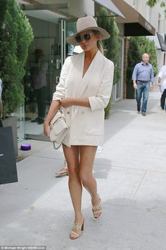 Forgotten something? Chrissy Teigen wore such tiny shorts on Wednesday when on a lunch dat...