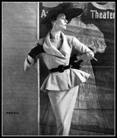 Gigi in dinner/theatre suit with flared peplum, by Jean Patou, photo by Henry Clarke, Vogue, May 15, 1951