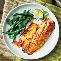 Sweet and Spicy Citrus Tilapia Recipe Main Dishes with tilapia fillets, cooking spray, fresh orange juice, fresh lime juice, brown sugar, extra-virgin olive oil, lower sodium soy sauce, salt, ground cumin, black pepper, ground red pepper, garlic cloves, paprika