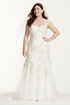 """Satin lace cap sleeve wedding dress is perfect for any bride who wants modern elegance mixed with Old Hollywood!  4"""" extra length gown.  Tulle over satin gown with lace cap sleeve beaded bodice features all over stunning embroidered applique detail.  Trumpet skirt and eye-catching key hole back adds drama and dimension.  Sizes 16W-26W. Chapel train.  Ivory/Gold and SolidWhite available online only.  Fully lined. Back zip. Imported polyester. Dry clean only.  Missy: Style WG3640. Si..."""