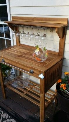 Beverage station made from potting bench.