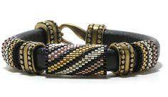 $35.00 Black Regaliz leather bracelet peyote by CinfulBeadPatterns Leather Jewelry, Beaded Jewelry, Beaded Bracelets, Seed Bead Projects, Beaded Leather Wraps, Peyote Stitch, Brick Stitch, Schmuck Design, Bracelet Patterns