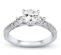My ideal engagement ring.  You can't see it from this view, but if you look at it at a lower angle the middle stones in their setting look like a blooming rose!!